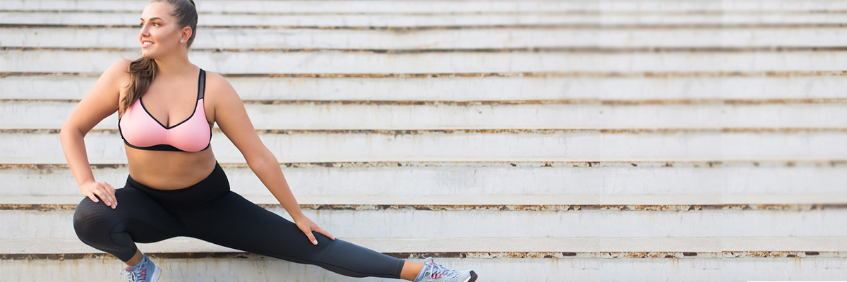 Woman stretching her legs on stairs