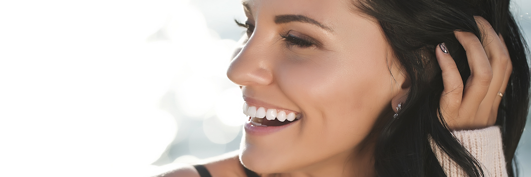 Woman laughing and looking to the side